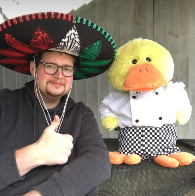 John wearing a sombrero next to toy duck Charlie