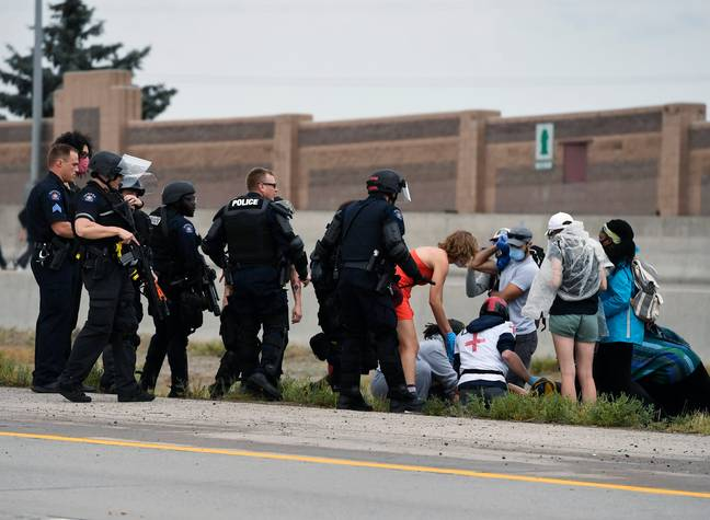 Protesters offer aid to injured person in Colorado