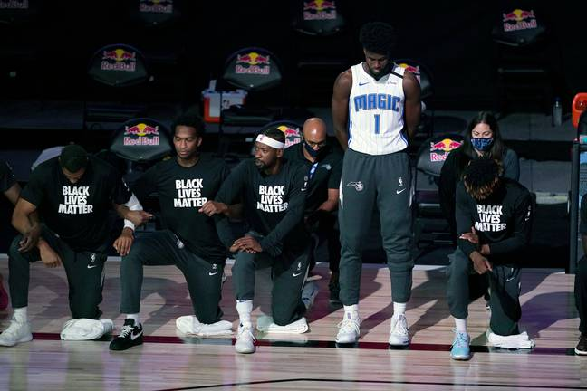Jonathan Isaac stands during national anthem