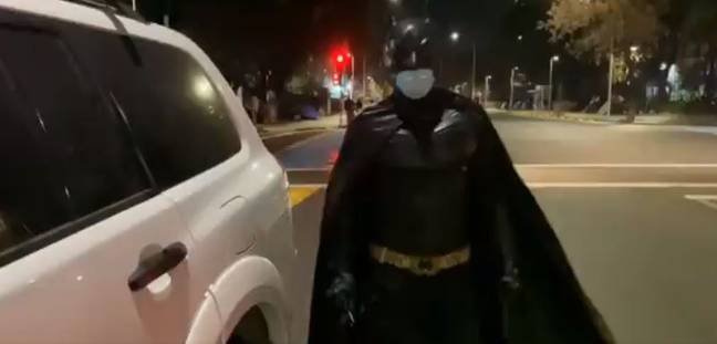 man dressed as batman delivers food to homeless