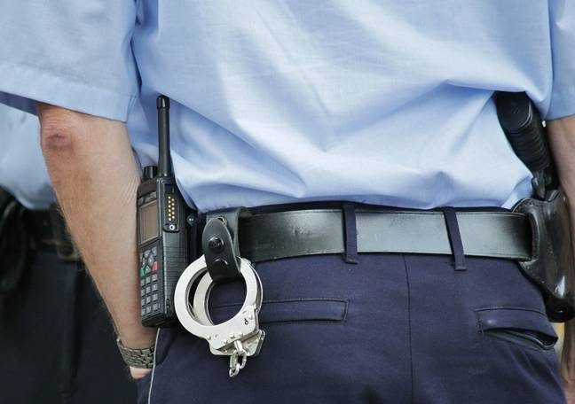 Police officer with handcuffs (Pixabay)