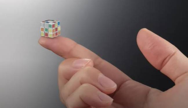 Tiny Rubik's Cube can fit on fingertips