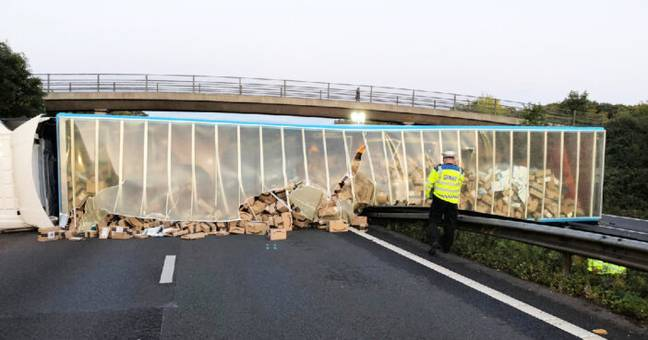 Hundreds Of Amazon Parcels Spill Across Motorway After Lorry Crashes