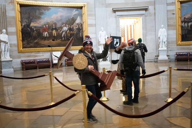 Lawyer For Capitol Rioter Who Stole Nancy Pelosi's Lectern Says Picture Is A 'Problem'