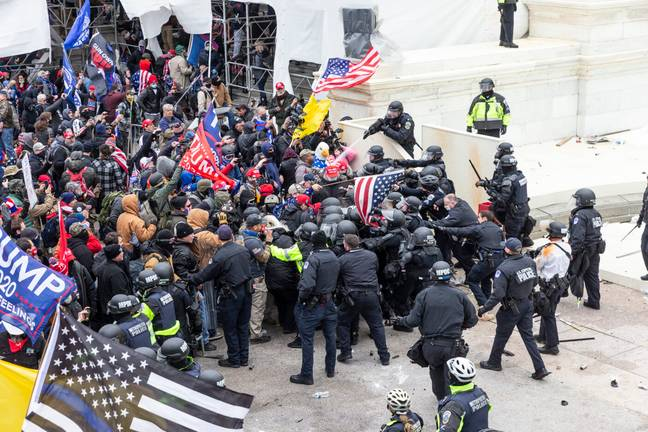 Officers fighting off rioters at the Capitol