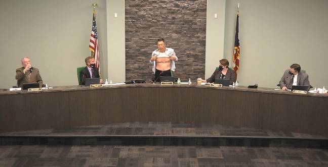 Asian US Army Veteran Shows Battle Scars At Town Hall Meeting, Asks Crowd If It's Patriotic Enough