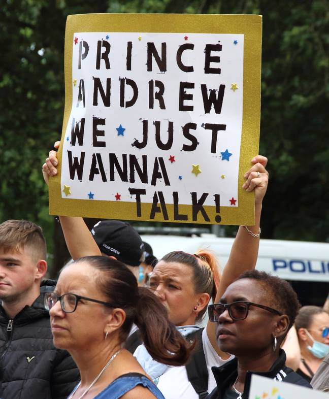 Protestors call on Prince Andrew to cooperate (PA Images)