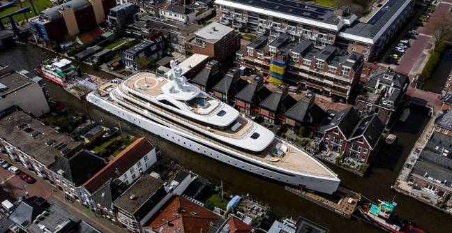 Massive Superyacht Caught Squeezing Down Tiny Dutch Canal