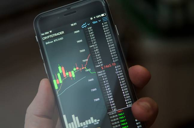Cryptotrader application is seen running on an iPhone PA