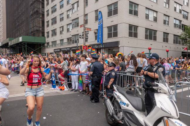 Police officers lining the parade route (PA Images)