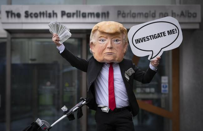 A Trump protester in Scotland. (PA Images)