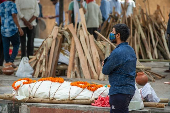 Man at funeral in India (PA Images)
