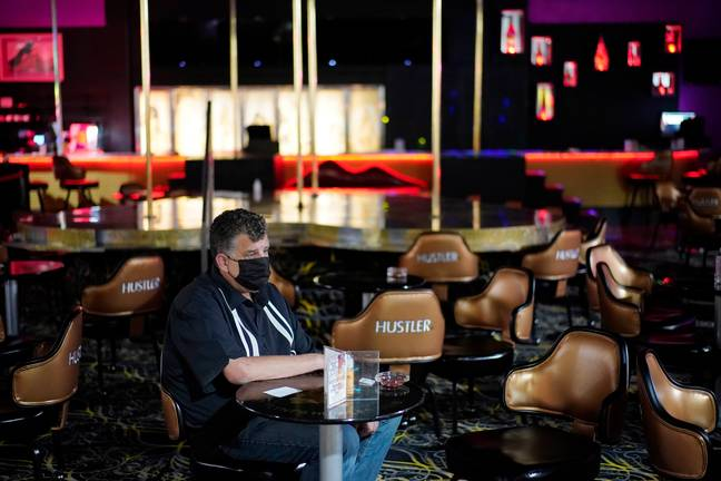 One customer waits inside Hustler Club after being vaccinated. (PA Images)