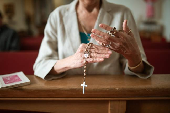 Woman with rosary beads in Church Pexels
