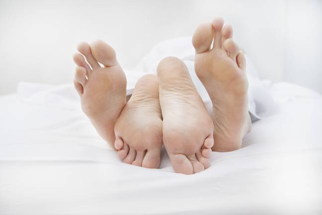 Couple's Feet In Bed (PA)