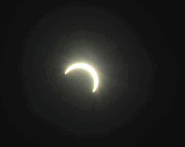 A crescent sun in India. (PA Images)