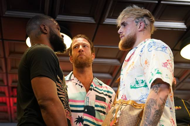 Jake Paul and Tyron Woodley facing off (PA Images)