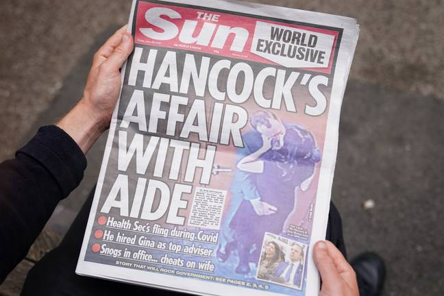 Hancock caught on camera having affair with aide (PA Images)