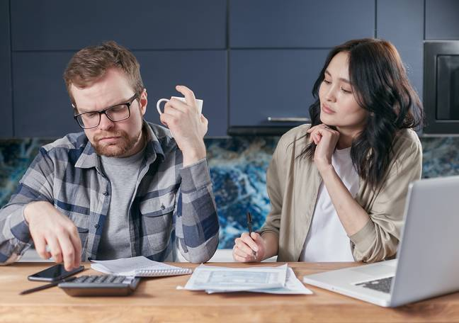 Couple looking at finances (Pexels)
