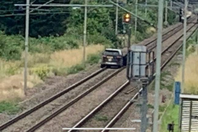 The car was later seen abandoned further down the railway (@ContainerDave/Twitter)