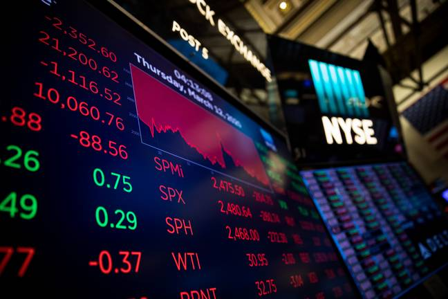 A monitor shows the trading infomation at the New York Stock Exchange (NYSE) (PA)