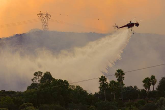 Large crane helicopters drop water on the Valley wild fire (PA)
