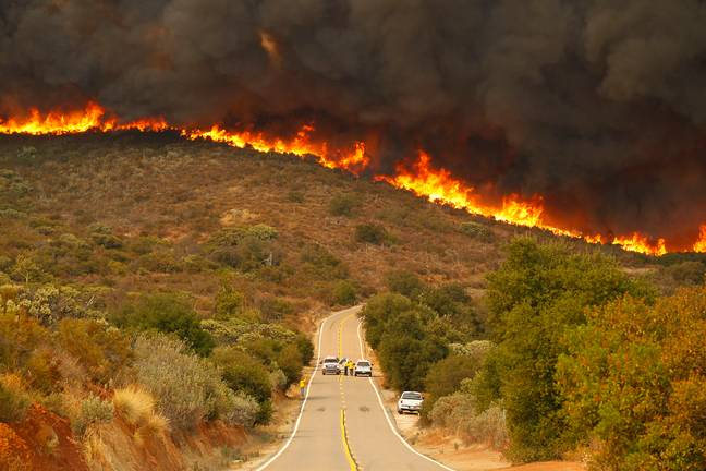 an Diego Sheriffs and CDF firefighters stage on Lyons Valley Road during the Valley Fire (PA)