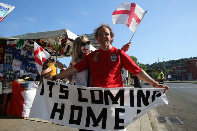 England fan with 'it's coming home' banner (PA Images)