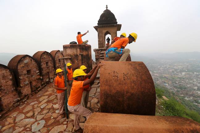 State Disaster Response personnel perform a search operation at a watchtower of the 12th century Amber Fort where 11 people were killed (PA)