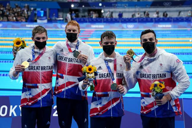 Team GB swimmers celebrate win (PA Images)
