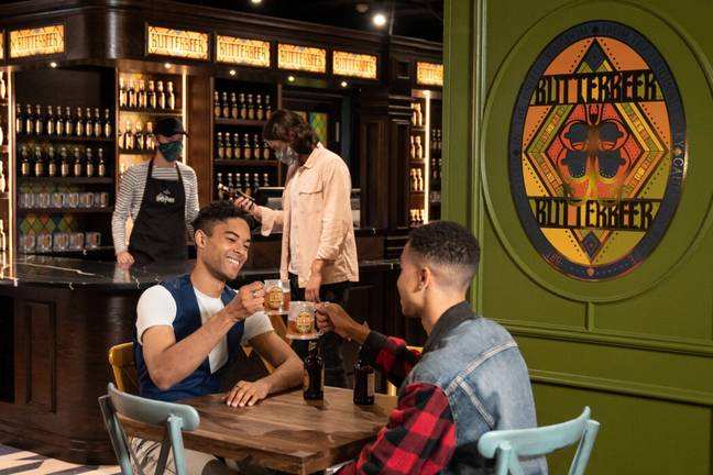 Fans can enjoy bottled Butterbeer at a dedicated bar (Harry Potter Photographic Exhibition)
