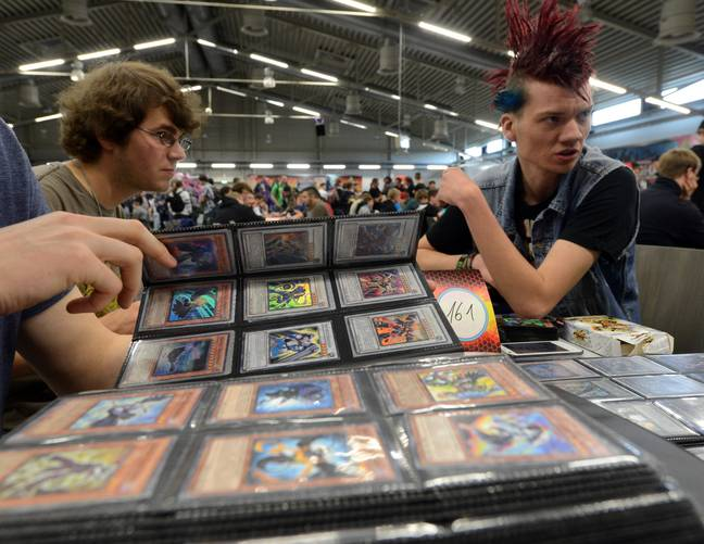 Players with Yu-Gi-Oh cards (PA Images)