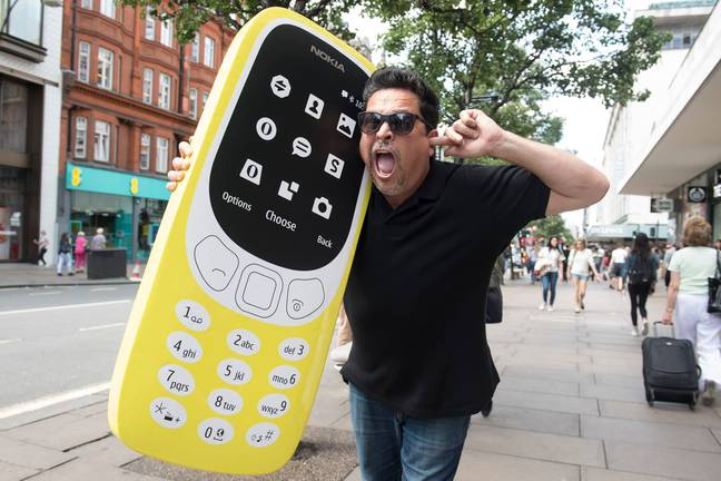 Comedian Dom Joly recreates a Trigger Happy TV moment to launch the new Nokia 3310 at Carphone Warehouse on Oxford Street, London.-Victoria Jones/PA Archive/PA Images
