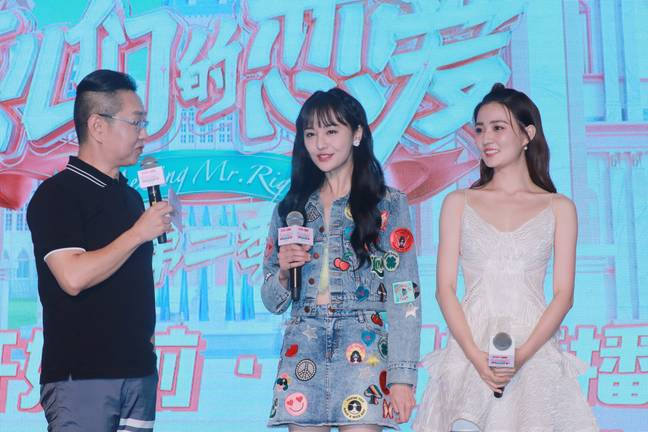 """Chinese actresses Zheng Shuang, center, and Xu Lu, right, attend a press conference for reality show """"Meeting Mr. Right"""" Season 2 in Shanghai, China, 22 August 2019 -Imaginechina/SIPA USA/PA Images"""