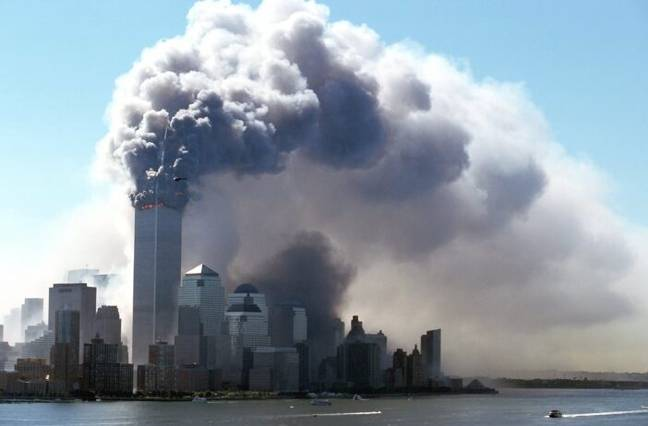 Smoke billowing from twin towers after plane crash (PA Images)