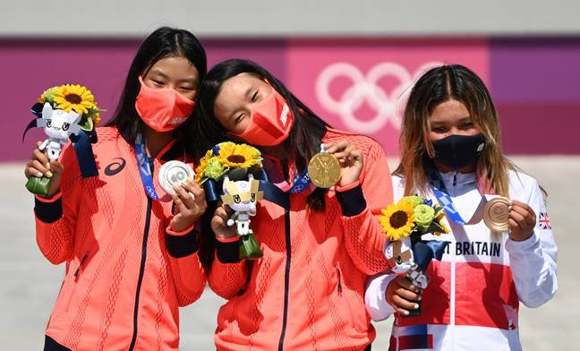 Kokona Hiraki (l-r) from Japan with silver medal next to Sakura Yosozumi from Japan with gold medal and Sky Brown from Great Britain with bronze (PA)