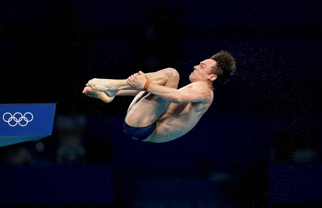 Tom Daley mid-dive at the Olympics. (PA Images)