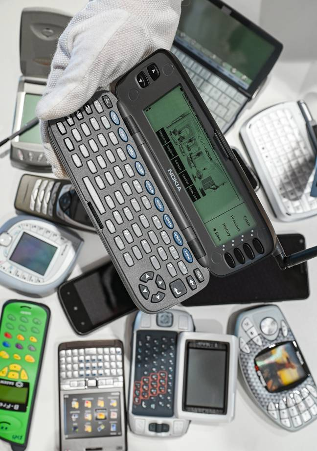 """12 August 2021, Hessen, Frankfurt/Main: ILLUSTRATION - A dummy of the """"Nokia 9000 Communicator"""" is held in front of various older mobile phone models on the sidelines of a press conference of the Frankfurt Museum of Communication for the online exhibition """"Smartphone.25 - Arne Dedert/DPA/PA Images"""