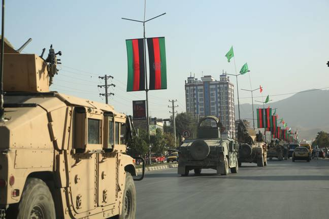 fghan army vehicles are seen on a road in Kabul (PA)