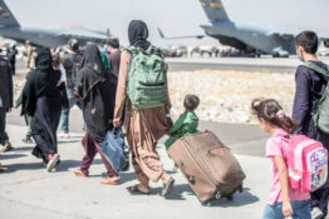 Evacuation operations at Hamid Karzai International Airport, Kabul, Afghanistan, on August 23, 2021, in the days following the fall of Kabul to Taliban movement, amid chaos and panic scenes at the capita -Balkis Press/ABACA/ABACA/PA Images