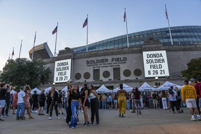 August 27, 2021: Fans take photos outside before attending a Kanye West ''Donda'' listening party at Soldier Field on Thursday, Aug. 26, 2021, in Chicago. -Armando L. Sanchez/Zuma Press/PA Images