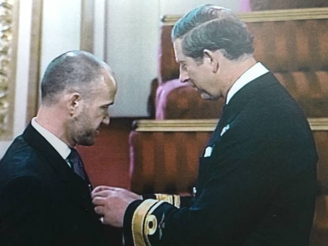 Garry being awarded QPM by Prince Charles (Supplied)