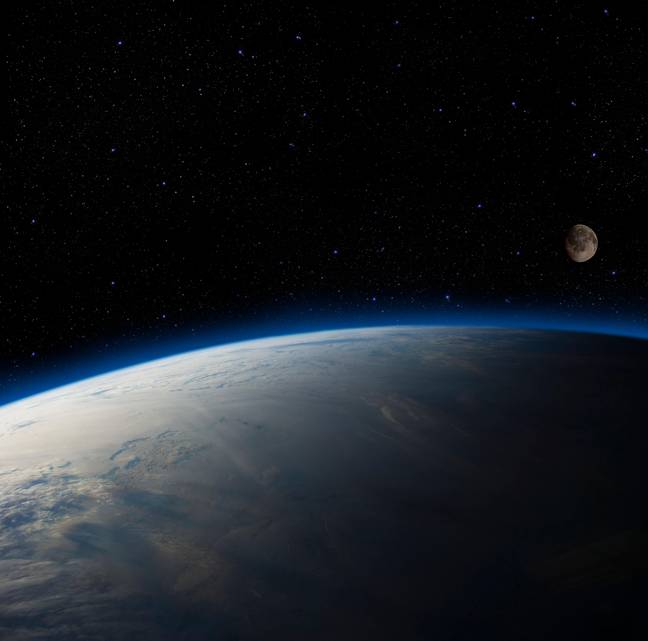 Earth overlooking the moon. Galaxy space filled with stars (Alamy)