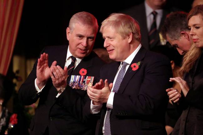 Duke of York (left) and Prime Minister Boris Johnson attend the annual Royal British Legion Festival of Remembrance at the Royal Albert Hall in Kensington, London. -Chris Jackson/PA Archive/PA Images