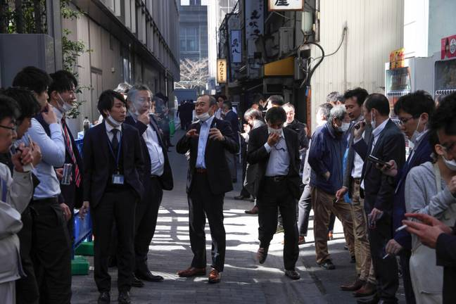 Japanese office workers smoking (PA Images)
