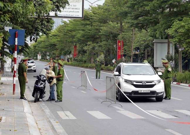 (210823) -- HANOI, Aug. 23, 2021 (Xinhua) -- Personnel are on duty on the street amid the COVID-19 pandemic in the Vietnamese capital Hanoi on Aug. 23, 2021. Vietnam reported 10,280 new COVID-19 infections on Monday, including 10,266 locally transmitted and 14 imported, according to its Ministry of Health. -unreguser/Xinhua News Agency/PA Images
