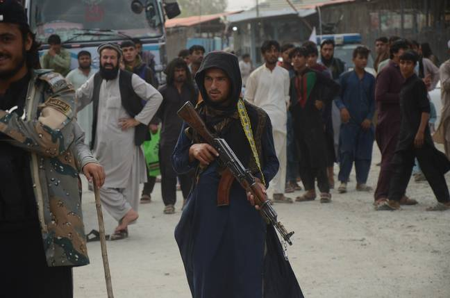A Taliban soldier guards a border crossing (PA Images)