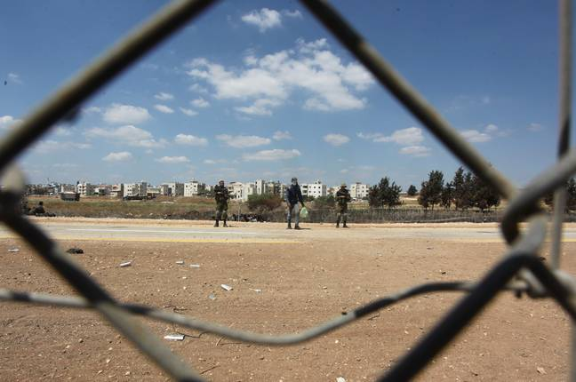 JENIN, Sept. 6, 2021 (Xinhua) -- Israeli soldiers stand guard in the West Bank city of Jenin, Sept. 6, 2021. Six Palestinian prisoners escaped from a prison in Israel on Monday, prompting a massive manhunt, Israeli authorities said. The extremely rare break-out took place overnight in the Gilboa Penitentiary, a high-security jail for Palestinian prisoners in northern Israel, the police said in a statement. -unreguser/Xinhua News Agency/PA Images