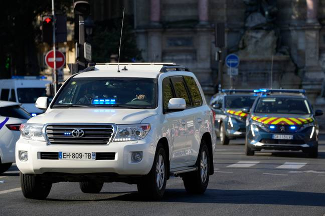 The car, left, carrying Salah Abdeslam arrives at the Palace of Justice Wednesday, Sept. 8, 2021 in Paris. France is putting on trial 20 men accused in the Islamic State group's 2015 attacks on Paris that left 130 people dead and hundreds injured. The proceedings begin Wednesday in an enormous custom-designed chamber. Most of the defendants face the maximum sentence of life in prison if convicted of complicity in the attacks. Only Abdeslam is charged with murder. -Francois Mori/AP/Press Association Images