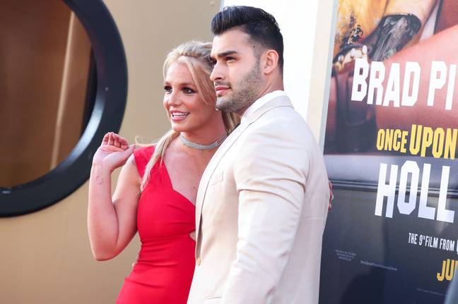 (FILE) Britney Spears Is Engaged to Sam Asghari After Nearly 5 Years Together. HOLLYWOOD, LOS ANGELES, CALIFORNIA, USA - JULY 22: Singer Britney Spears and boyfriend/personal trainer Sam Asghari arrive at the World Premiere Of Sony Pictures' 'Once Upon a Time In Hollywood' held at the TCL Chinese Theatre IMAX on July 22, 2019 in Hollywood, Los Angeles, California, United States. -Image Press Agency/SIPA USA/PA Images